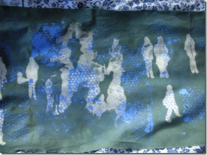 discharged fabric showing shadowy figures