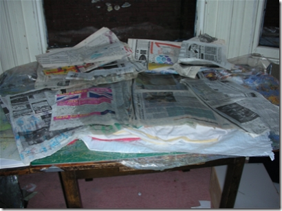 table covered in damp newspaper