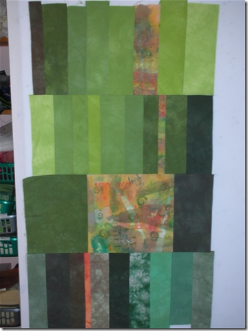 green quilt with orange patches
