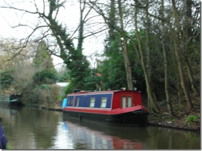 canal with barge moored alongside bank