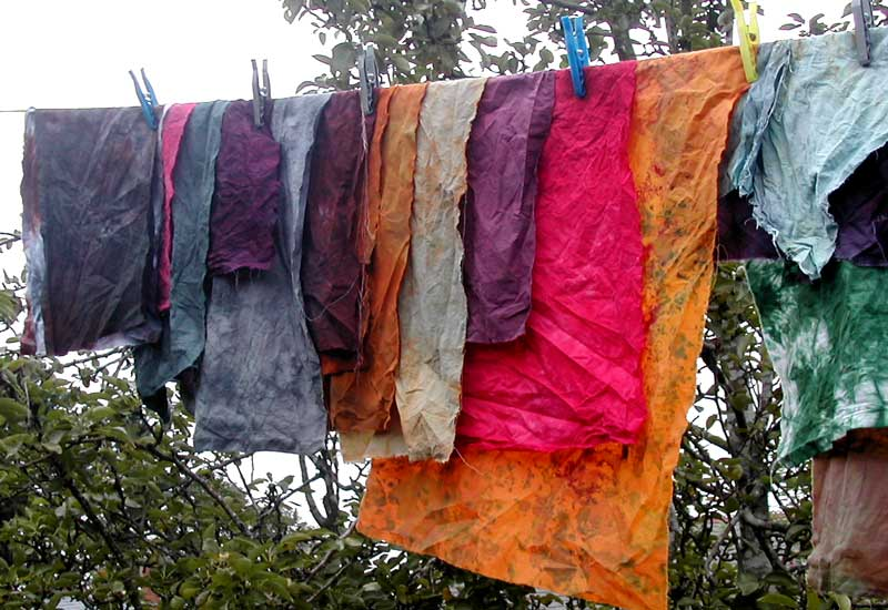 dyed fabric hanging out to dry