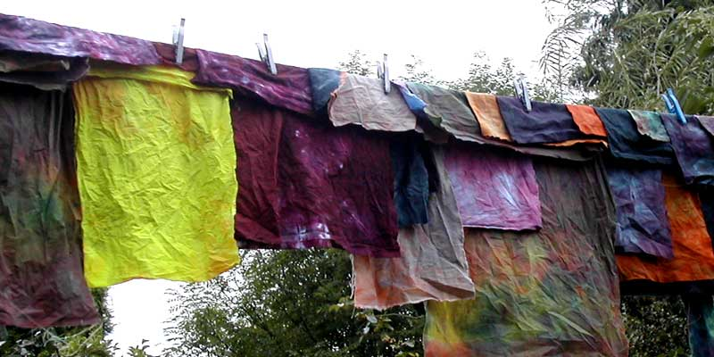 yellow and purple dyed fabric on washing line