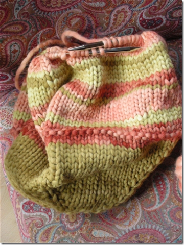knitted bag in greens and pinks