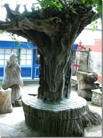 sculpture in tree trunk