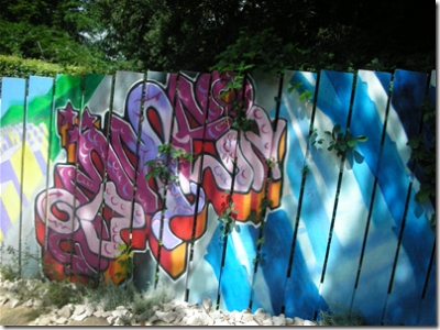 fence with graffiti