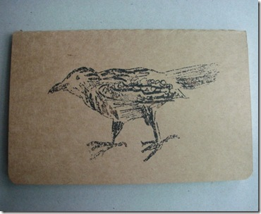 crow Gocco print on Moleskine notebook