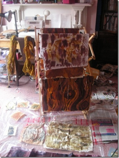 ochre painted fabric in studio
