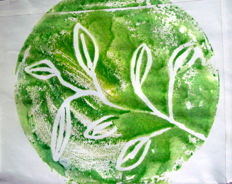 green circle with white leaves printed