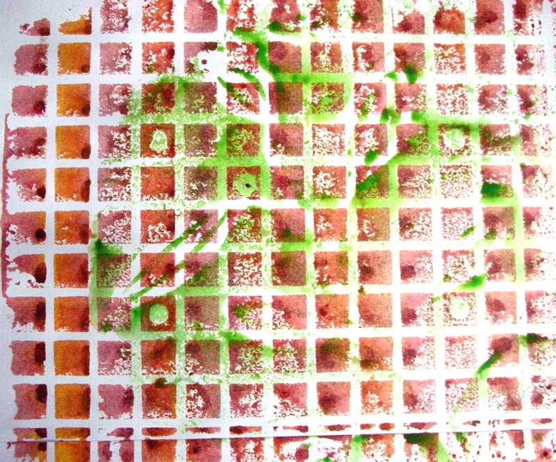 green paint overprinted on to red squares