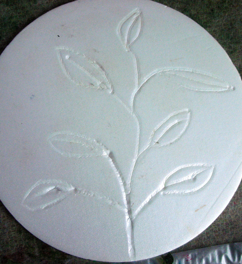 stem and leaves drawn into polystyrene base