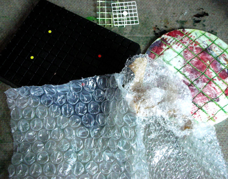 a pile of bubble wrap and other textured objects