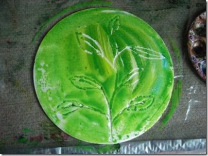 green paint brushed on to polystyrene plate