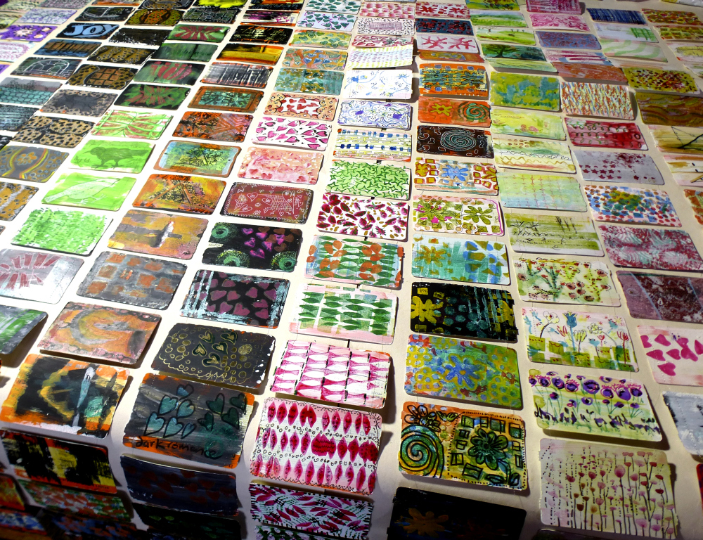 train ticket art laid out in rows