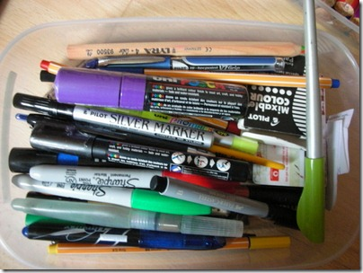 stash of pens and markers