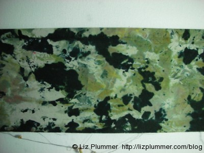 green and black dyed fabric