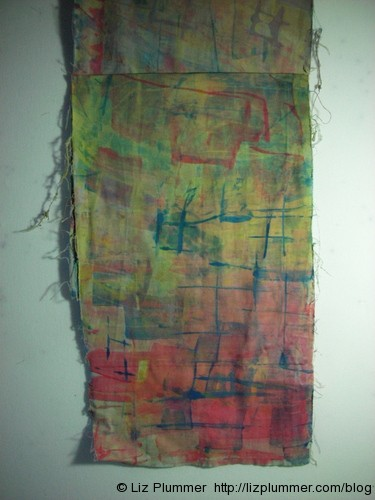 yellow, blue and red scraped fabric