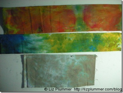 strips of ice dyed fabric - orange, yellow/green/blue and browny grey