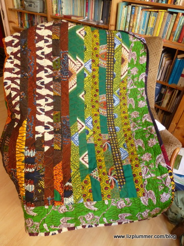 African quilt draped over chair
