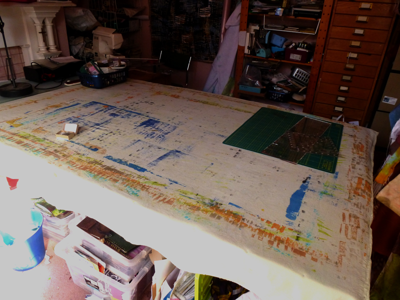 table with dropcloth for ink stains
