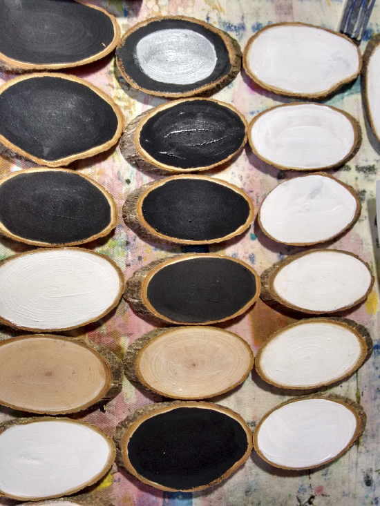 lines of wood slices painted with gesso