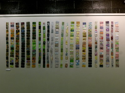 train ticket art hanging in rows on wall in Riverfront Art Centre