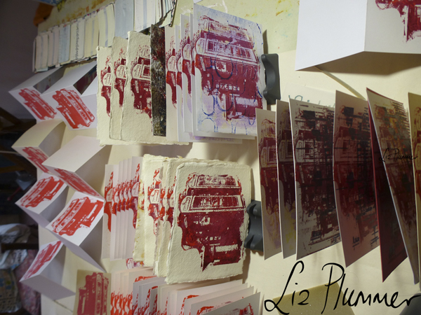 gocco prints stacked in rack to dry
